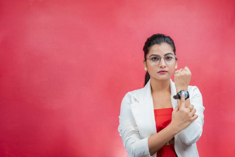 Confident woman showing wrist watch 23913 pixahive 1024x683